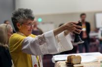 Bishop Peggy Johnson leads a communion service during the 2016 United Methodist General Conference in Portland, Ore. Photo by Kathleen Barry, UMNS