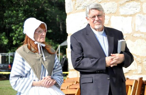 Bishop Peggy Johnson, dressed as Eva Boehm in a red wig and colonial garb, stands next to the Rev. Alfred Day, United Methodist Commission on Archives and History, during a service at Boehm's Chapel. Photo by John Coleman, Eastern Pennsylvania Conference