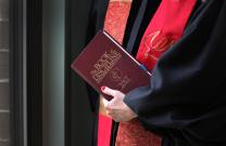 The 2012 Book of Discipline of The United Methodist Church is held by an ordained elder. General Conference is expected to debate what church teaches about ministry with gay individuals. Photo illustration by Kathleen Barry, United Methodist Communications