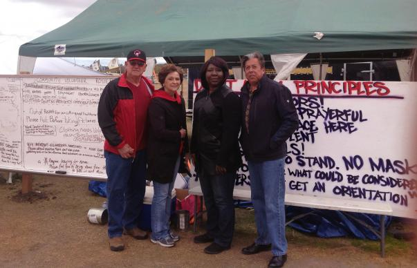 From left, Gary and Louise Niemann from the Great Plains Conference, Erin Hawkins of the United Methodist Commission on Religion and Race and the Rev. David Wilson of the Oklahoma Indian Missionary Conference, visited the campsite in mid-October to support peaceful protests against the pipeline. Photo courtesy of Erin Hawkins, United Methodist Commission on Religion and Race.