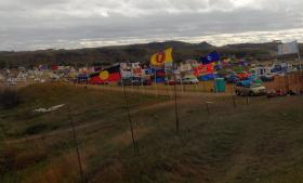 A line of flags marks a campsite near Cannon Ball, N.D., occupied by members of the Standing Rock Sioux Tribe who are protesting the Dakota Access Pipeline.  Photo by Erin Hawkins, United Methodist Commission on Religion and Race.