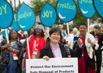 Cristina Manabat of the Philippines (front) joins a United Methodist Women's rally for the right to clean water for all outside the 2016 United Methodist General Conference in Portland, Ore. Photo by Mike DuBose, UMNS.