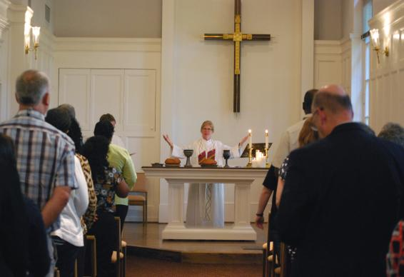 The Rev. Susan Henry-Crowe, top executive of the United Methodist Board of Church and Society, presides over communion during the board's Sept. 23 worship service at the chapel in the United Methodist Building on Capitol Hill.