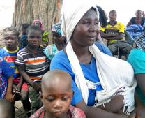 A woman holds a baby while seated among refugees at the United Methodist Church ATC/Nukkai in Jalingo, Nigeria. United Methodist churches in Nigeria are serving as refugee camps for people displaced after attacks on villages in Lau, a local government area in Taraba State in Northern Nigeria. Photo by the Rev. Ande I. Emmanuel, UMNS.