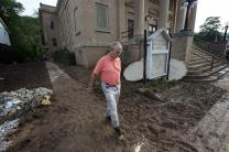 The Rev. J.F. Lacaria surveys flood damage at Clendenin (W. Va.) United Methodist Church. Photo by Mike DuBose, UMNS
