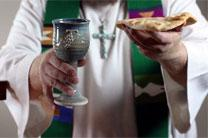 A member of the clergy holds up the elements of Holy Communion. In 2005, the average age of retiring United Methodist elders was 64, but by 2015 that had climbed to 66, the Lewis Center found. Photo illustration by Kathleen Barry, United Methodist Communications.