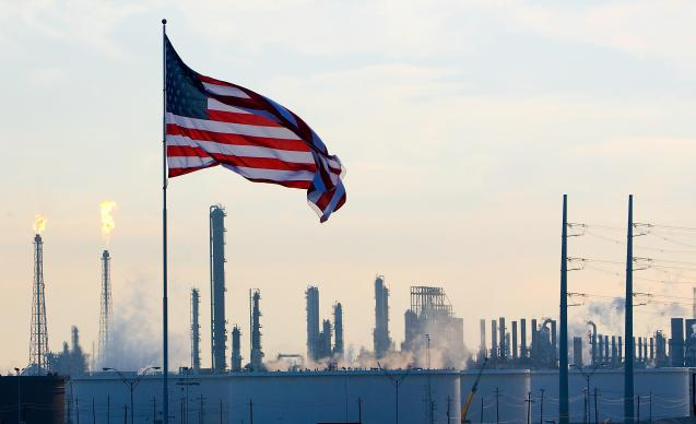 A U.S. flag flies above an oil refinery near Houston in 2008. Some United Methodists are calling for divestment from the fossil fuel industry. File photo by Mike DuBose, UMNS