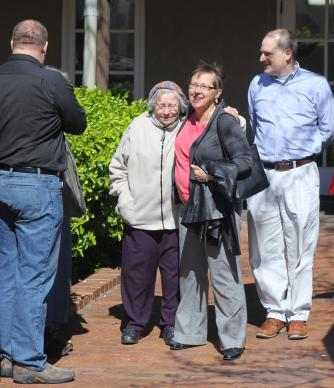The Rev. Cynthia Meyer (second from right) gets a hug and well wishes from supporters after a meeting with Bishop Scott Jones March 28 in Wichita, Kan. A complaint against Meyer ended Aug. 1. Photo by Todd Seifert, Great Plains Conference