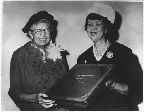 Eleanor Roosevelt receives the Mary McLeod Bethune Human Rights Award from Dorothy Height, president of the National Council of Negro Women, at the Council's Silver Anniversary Dinner in New York, Nov. 12, 1960. Photo courtesy of the National Archives and Records Administration.