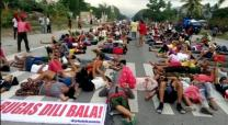 Farmers (many of them Lumads) stage a die-in protest along General Santos-Cotabato national highway in Koronadal City, Philippines, to raise their demand to the government for the immediate release of calamity funds and justice to the farmers of North Cotabato who were violently dispersed last April 1 in Kidapawan City.