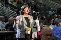 Barbara Boigegrain, top executive of the United Methodist Board of Pensions and Health Benefits, provides information on the board's fossil fuel investments to delegates at the May 20 plenary session of the denomination's 2016 General Conference in Portland, Ore. Photo by Maile Bradfield, UMNS.