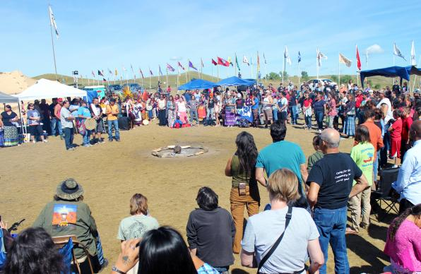 Presentation of the flags at the main circle of the Oceti Sakowin Camp, near Cannon Ball, ND.