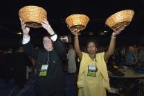 A woman and man hold high collection baskets during the offering in the April 24 opening worship service of the 2012 United Methodist General Conference in Tampa, Fla.  Giving and the church budget are topics that the 2016 General Conference takes up when it meets in May. File photo by Paul Jeffrey, UMNS.