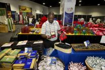 Charles Murithi, a reserve delegate from Nebraska, shops at the Cokesbury booth during the 2012 United Methodist General Conference in Tampa, Fla. The Discovery Institute, a policy think tank, sought a display at the 2016 General Conference and has protested the denial of its request. Photo by Mike DuBose, UMNS