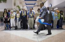 Oklahoma Area Bishop Robert E. Hayes Jr. walks past supporters of full inclusion for gays and lesbians in the life of The United Methodist Church who are standing in silent vigil as delegates and visitors leave a session of the denomination's 2012 General Conference in Tampa, Fla. Hayes had presided over the previous session of the conference. Photo by Mike DuBose, UMNS