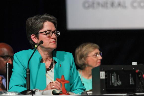 Bishop Sally Dyck, Chicago Episcopal Area, presides over the May 20 plenary session of the 2016 United Methodist General Conference in Portland, Ore. Behind her are Bishops Gregory Palmer and Janice Riggle Huie. Photo by Maile Bradfield, UMNS.