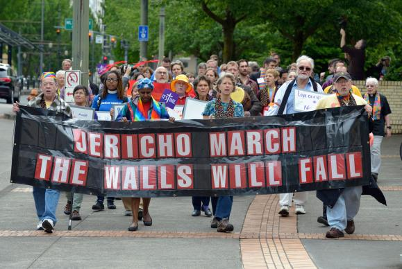 Rights activists march on May 16 around the Oregon Convention Center, the site of the 2016 United Methodist General Conference in Portland, Ore. Using the theme of Jericho in which walls were brought down, the demonstrators were demanding that the church be more inclusive of LGBTQ people in its ministries. Photo by Paul Jeffrey, UMNS.
