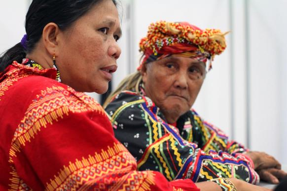 Norma Capuyan and Monico Cayon, indigenous leaders from the island of Mindanao in the southern Philippines, answer questions in the news area at the 2016 United Methodist General Conference at the Oregon Convention Center in Portland. Photo by Kathleen Barry, UMNS