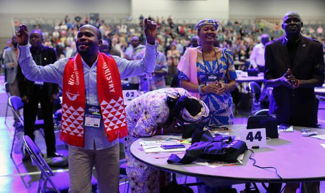 Morning worship by delegates Ande Emmanuel, Eunice Iliya, Joyce Madanga and Habila Bala, delegates from Southern Nigeria Conference, react to the morning worship music at the 2016 United Methodist General Conference at the Portland Convention Center. Photo by Kathleen Barry, UMNS.