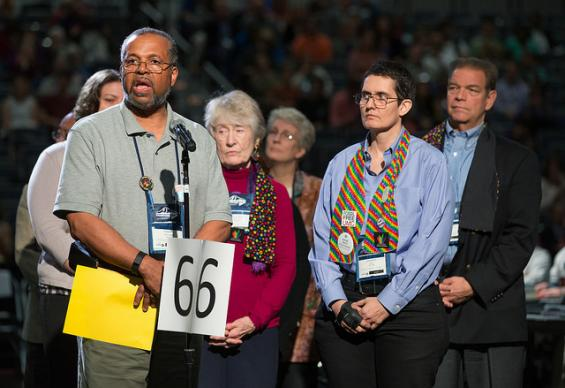 Delegate Fred Brewington (at microphone) asks the 2016 United Methodist General Conference meeting in Portland, Ore., to apologize to fellow delegate Dorothee Benz (second from right) after she was ruled out of order while trying to speak about issues of human sexuality in an earlier session. Photo by Mike DuBose, UMNS