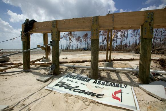 Foundation pilings and a plastic sign are all that remain of a building at the historic Gulfside Assembly grounds in Waveland, Miss., following Hurricane Katrina in 2005.
