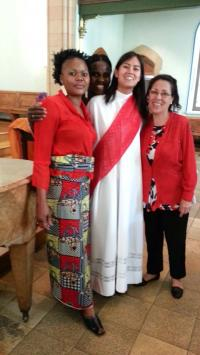 The women's singing group, the Rev. Erika Stalcup, center, prepare multilingual songs for Pentecost. Photo courtesy of the Rev. Erika Stalcup, Eglise Evangélique Méthodiste.