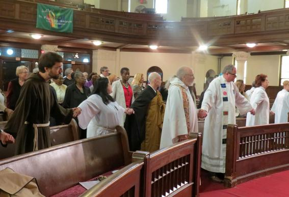 Participants join hands during an April 25 interfaith prayer vigil on immigration reform at the United Methodist Church of St. Paul and St. Andrew in New York. Photo by the Rev. Joanne Utley, New York Conference