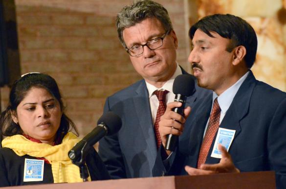 Insar Gohar, right, staff with the Church of Pakistan, and his wife, Uzma Insar, left, share their story with Thomas Kemper, center, top executive of the United Methodist Board of Global Ministries, and the agency's board of directors during an April 2014 board meeting in New York. Photo by Cassandra Heller, Global Ministries