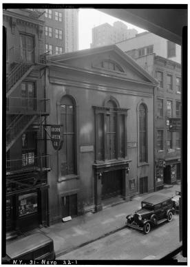 A view of John Street Methodist Episcopal Church in New York, NY, taken by E. P. MacFarland in 1934 for the Historic American Buildings Survey. The Historic American Building Survey was a program of the National Park Service established to document historic places. Photo from Library of Congress Prints and Photographs Division, Washington, courtesy of Wikimedia Commons