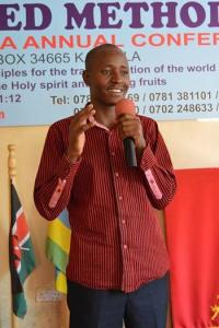 Joseph Kanyike speaks in this 2011 photo during a youth service at Kireka United Methodist Church. He is among the United Methodists pushing for greater financial accountability among bishops. Photo courtesy of Joseph Kanyike