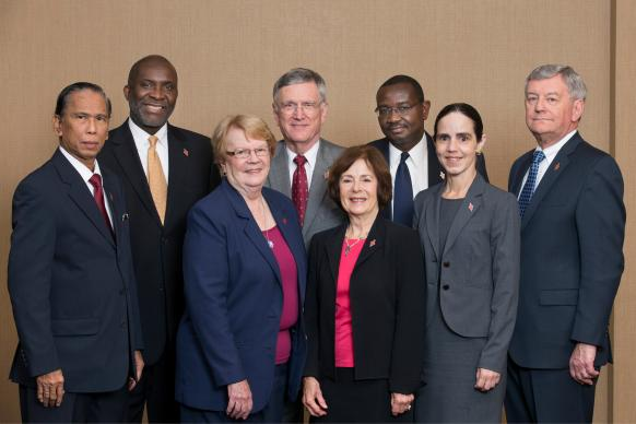 Members of the United Methodist Judicial Council pose for a group photograph during their Oct. 22, 2014 meeting in Memphis, Tenn. The men, from left, are: Ruben T. Reyes, the Rev. Dennis Blackwell, the Rev. Belton Joyner, N. Oswald Tweh Sr. and the Rev. William B. Lawrence. The women, from left, are: Sandra Lutz, the Rev. Kathi Austin Mahle and Beth Capen. Not pictured is the Rev. J. Kabamba Kiboko. Photo by Mike Dubose, UMNS
