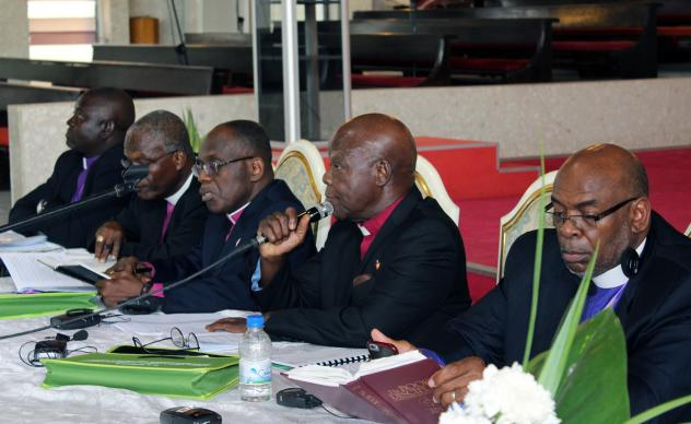 Interim Bishop Arthur Kulah, second from right, presides over discussion about bishop qualifications in the United Methodist Book of Discipline. Photo by Julu Swen, UMNS