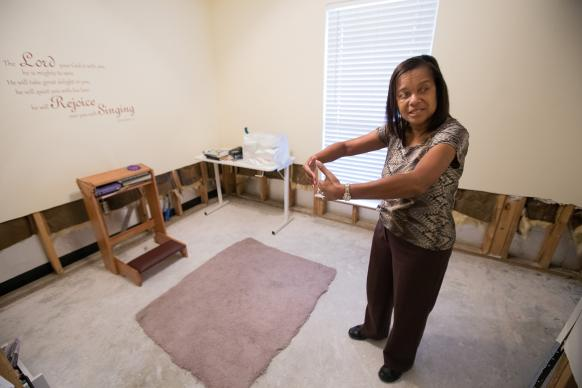 Kathleen Conrad describes the size of the one dry spot left on the carpet at her home in Baton Rouge, La., after recent flooding. The dry area was in her prayer room at the spot where she routinely kneels to pray.