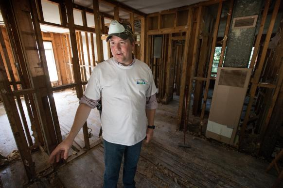 The Rev. Brady Whitton, senior pastor of First United Methodist Church in Baton Rouge, discusses the progress made by volunteer teams from his church in gutting the walls of a flood-damaged home. Photo by Mike DuBose, UMNS