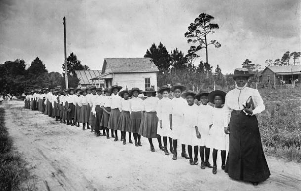 Mary McLeod Bethune with a line of girls from the Daytona Literary and Industrial School for Training Negro Girls, Daytona Beach, Florida, 1905. Photo courtesy of the State Archives of Florida, Florida Memory.