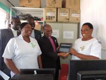 The computerization of this rural health facility impresses Bishop Eben Kanukayi Nhiwatiwa. Photo by Taurai Emmanuel Maforo, UMNS