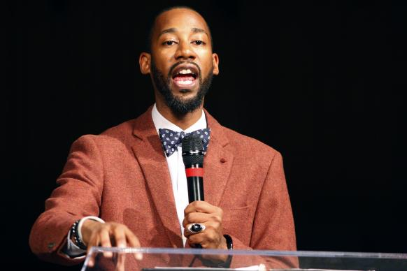 "Damien Durr, one of the members of the Children's Defense Fund team from Nashville, Tenn., gives the keynote address, ""From Tragedy to Transformation,"" during The School-to-Prison Pipeline educator's summit at Concord Church of Dallas. Photo by Kathy L. Gilbert, UMNS."