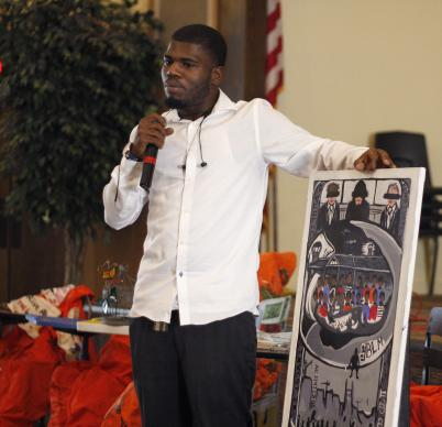 E'darrius Smith, a recent high school graduate, shared his activism art in a workshop during  The School-to-Prison Pipeline educator's summit at Concord Church of Dallas. He talked about three presidents who he said passed laws that resulted in the mass incarceration of people of color. Photo by Kathy L. Gilbert, UMNS.