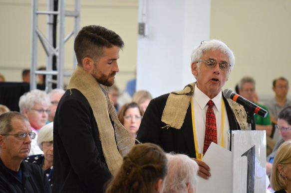 The Revs. Will Green (left) and John Blackadar offer a resolution that the New England Conference of The United Methodist Church
