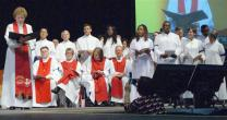 Bishop Jane Allen Middleton, left, examines the candidates for commissioning as elders and deacons during the 217th session of the New York Annual Conference at Hofstra University. Four openly gay candidates were among those commissioned or ordained in June. Photo by Stephanie Parsons, courtesy of New York Conference.
