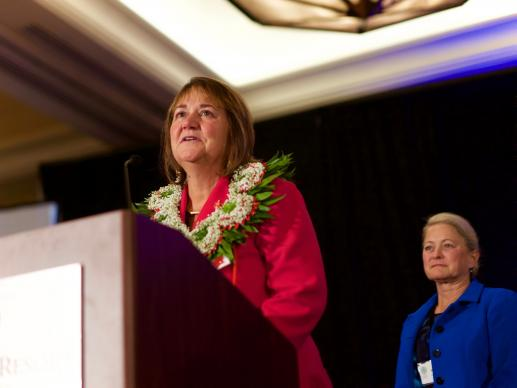 The Rev. Karen Oliveto accepts her election by the Western Jurisdiction as a United Methodist bishop. Oliveto is currently the senior pastor at Glide Memorial United Methodist Church in San Francisco, Calif. Her wife, Robin Ridenour, stands behind her. Photo by Patrick Scriven, Pacific-Northwest Conference.