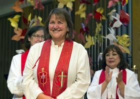 Newly elected Bishop Karen Oliveto, a married lesbian who has become the first openly gay bishop of The United Methodist Church, stands with Big Sky Area Bishop Elaine Stanovsky, left, and Los Angeles Area Bishop Minerva Carcaño. Photo by Charmaine Robledo, Mountain Sky Episcopal Area.