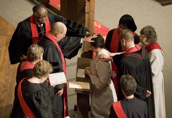 Laura Kirkpatrick (center) is ordained during the 2008 Tennessee Annual Conference of The United Methodist Church in Murfreesboro, Tenn. File photo by Mike DuBose, UMNS