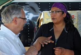 Bishop Bruce Ough and Jennifer Martell of Sitting Bull College met at a camp near Cannon Ball, N.D., on Sept. 10. The camp has been a gathering place for opposition by the Standing Rock Sioux and many others to the Dakota Access Pipeline. Photo by Dave Stucke, Dakotas Conference.