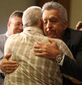 Newly elected Bishop Ruben Saenz Jr. embraces a delegate to the South Central Jurisdictional Conference after winning election during the conference July 14, 2016, in Wichita. Photo by Todd Seifert, Great Plains Conference.