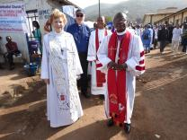 "United Methodist clergy lead the ""march past,"" marking the beginning of the 136th session of the Sierra Leone Annual Conference at Brown Memorial United Methodist Church. In the foreground are Bishops Jane Allen Middleton, New York Conference and John G. Innis, Liberia."