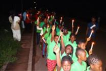 Children lead a candlelight procession into the Moyamba community before attending a social night at the Sierra Leone Conference's children's camp in late July. Photo by Phileas Jusu, United Methodist Communications.
