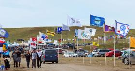 Flags line the road at a camp near Cannon Ball, N.D., center of protest of the Dakota Access Pipeline. United Methodist pastors will be joining others at the camp on Nov. 3, to support the Standing Rock Sioux, who say the pipeline will cross sacred lands and threaten the local drinking water. Photo by Dave Stucke, Dakotas Conference.