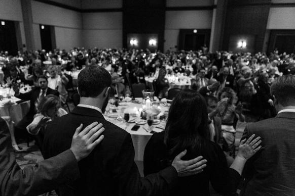 Seminary students receive a blessing from those in attendance at the 2016 Dinner of Celebration in Montgomery, Ala., as they prepare to depart to their respective seminaries. Photo by Luke Lucas, Alabama-West Florida Conference, courtesy of the Stegall Seminary Scholarship Endowment Foundation.