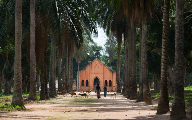 The United Methodist Church at the Tunda Mission Station stands at the end of a tree-lined street in Tunda, Democratic Republic of Congo.